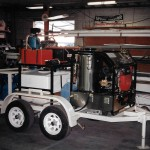 mobile pressure washer with trailer and hose rails